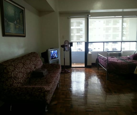 Studio unit is very spacious, has a balcony and faces the morning sun  making it cool inside from morning till evening.