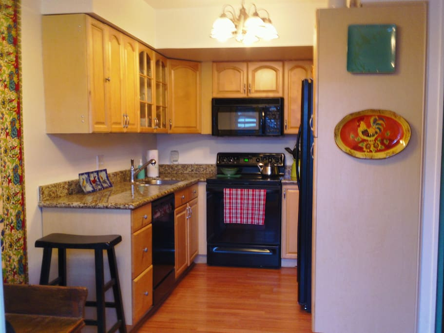 Fully equipped kitchen includes dishes, pots and pans.