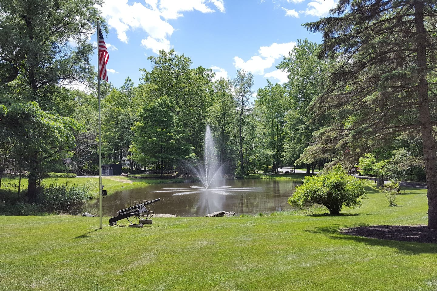 Pond With Fountain, Cannon & Flag