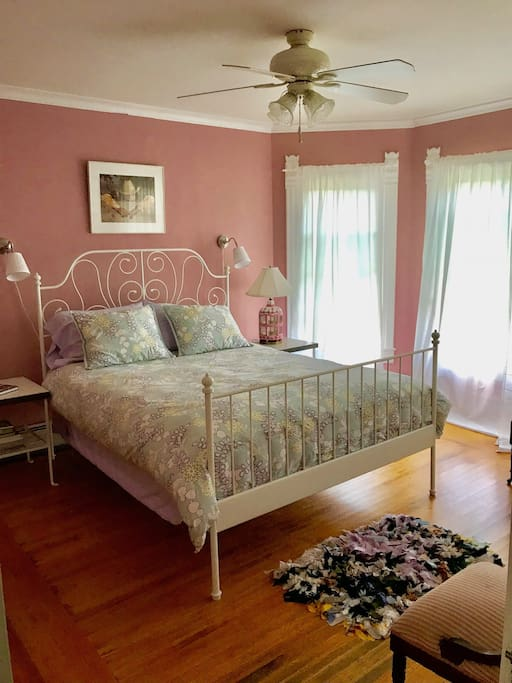 Pink Room: Has one queen bed and shares a large full bathroom with the Blue room.