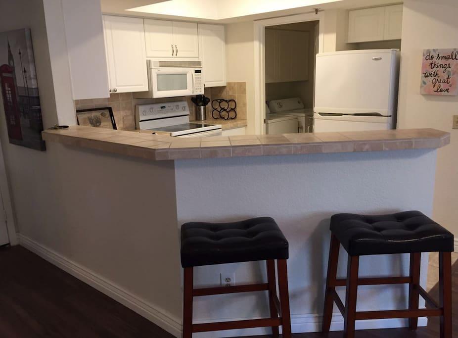Kitchen with raised breakfast bar