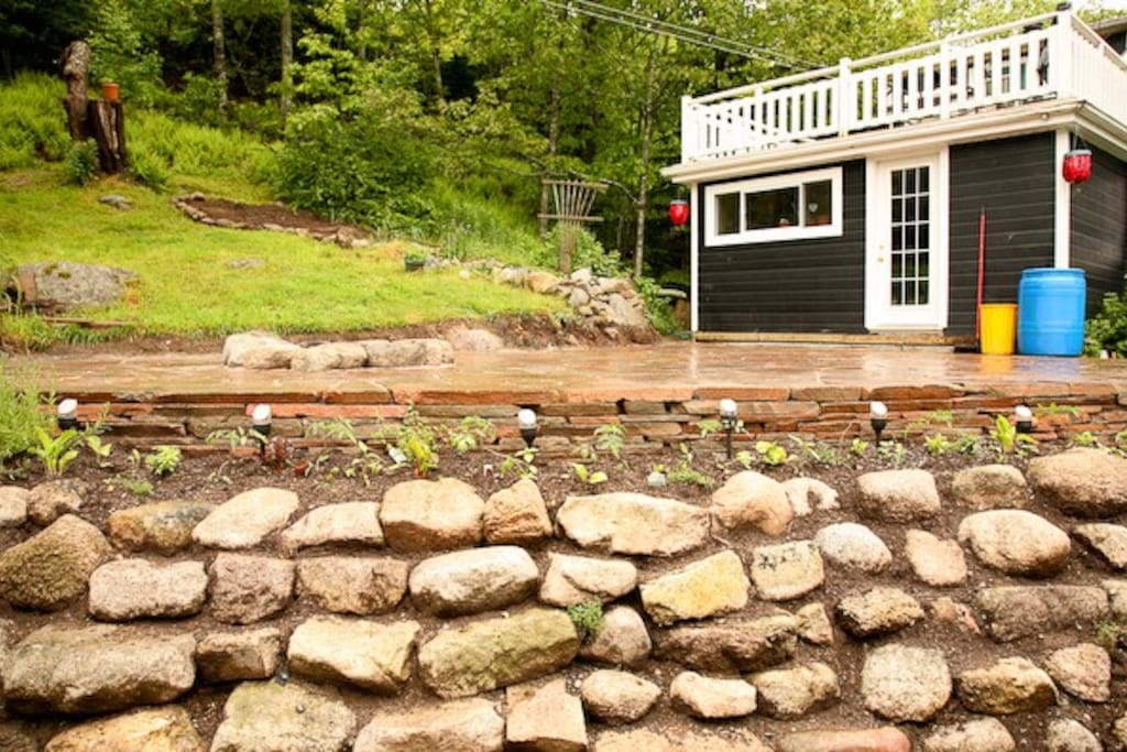 Backyard rock patio with campfire area perfect for relaxing or social gatherings