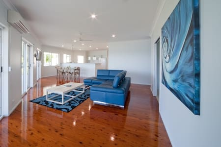 Holiday home with two self contained suites in Shute Harbour 10KM from Airlie Beach.  Each suite sleeps 8 and can be rented individually or together.  The Whitsunday Suite is on the upper level and has a swimming pool.  This home has beautiful views!