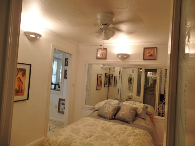 Ceiling fan above the bed