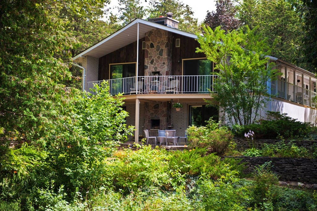 This is the entrance and walk out to the beautiful deck, equipped with outdoor patio furniture. Your unit will be the lower floor which gives you direct access to the backyard.