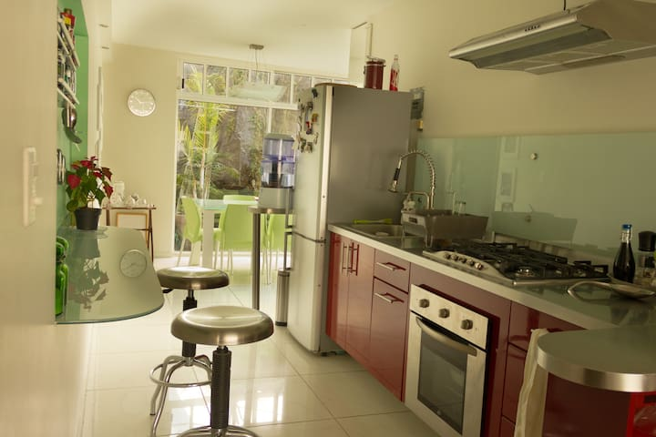 Kitchen is between the living room and terrace.