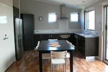 Kitchen. Dining area with large double door fridge and dishwasher