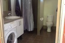 Private En-suite Bathroom with under bench front load washing machine