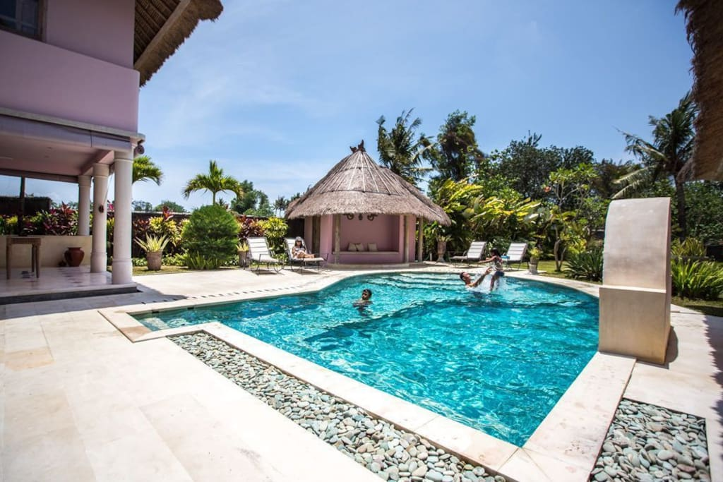 Large private pool and lush gardens.