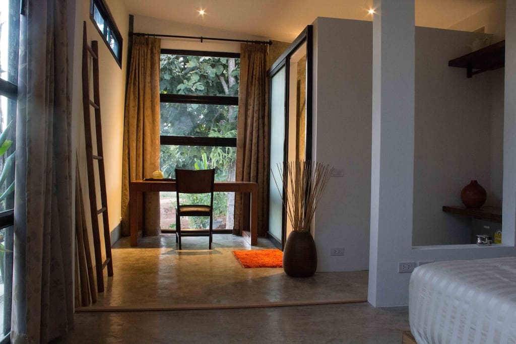 Spacious room with office desk and garden view