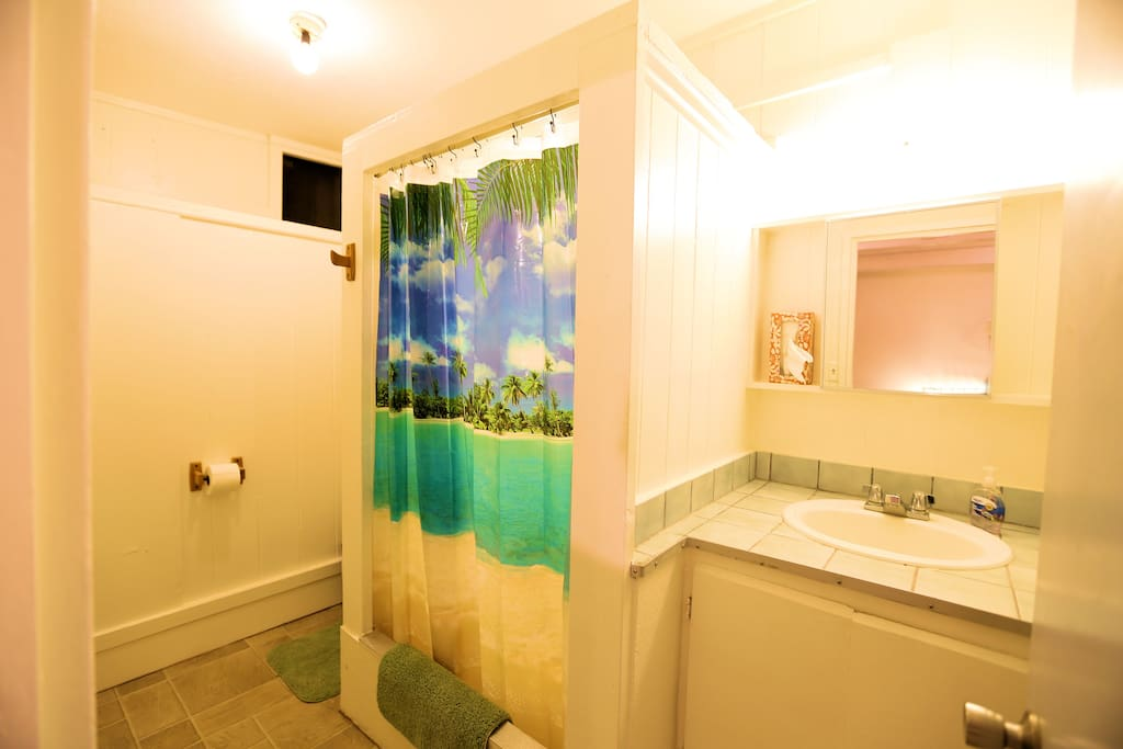 An efficient bathroom, all you need. Plenty of cotton towels