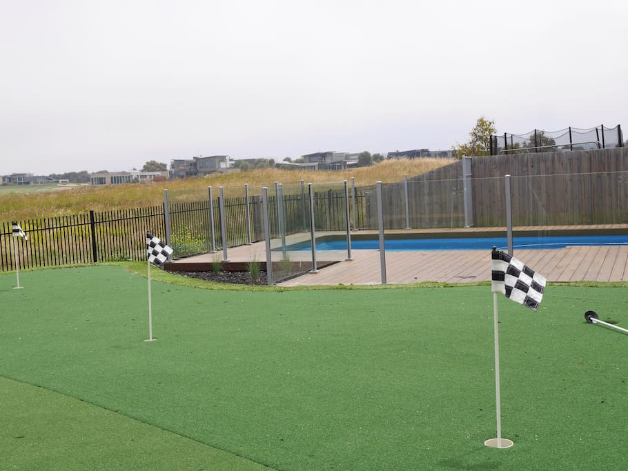 Private 4 hole putting green and solar heated swimming pool.