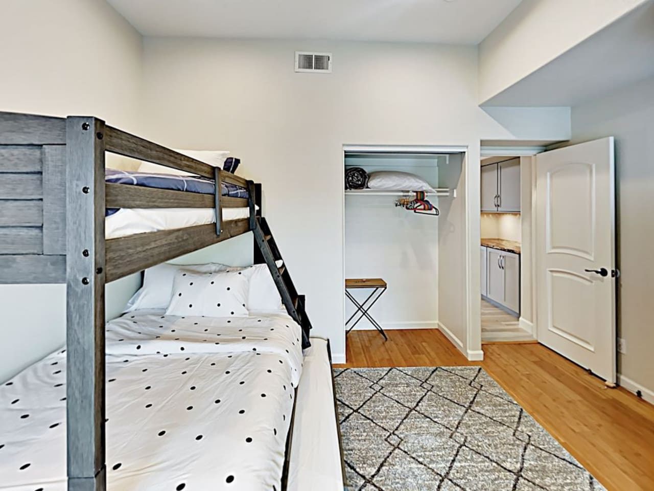 Bedroom 4 with a bunk bed (one full + one twin + trundler)