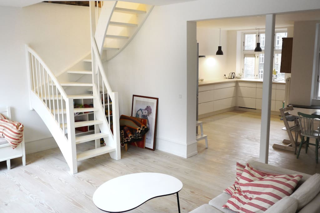 Livingroom and staircase to the second floor of the apartment
