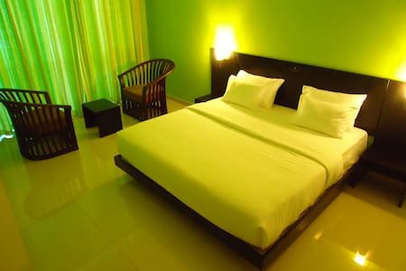 Deluxe sea view Room-AC/Wifi/Balcony/Hotwater