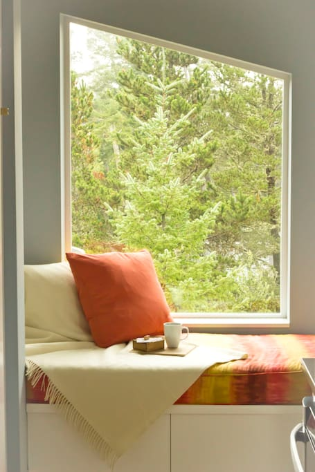 Sun-drenched window-seat - the perfect place to curl up with a good book!