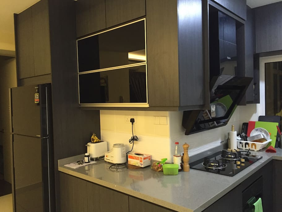 Fully equipped kitchen with toaster, built-in oven, stove, fridge, washer and drying area