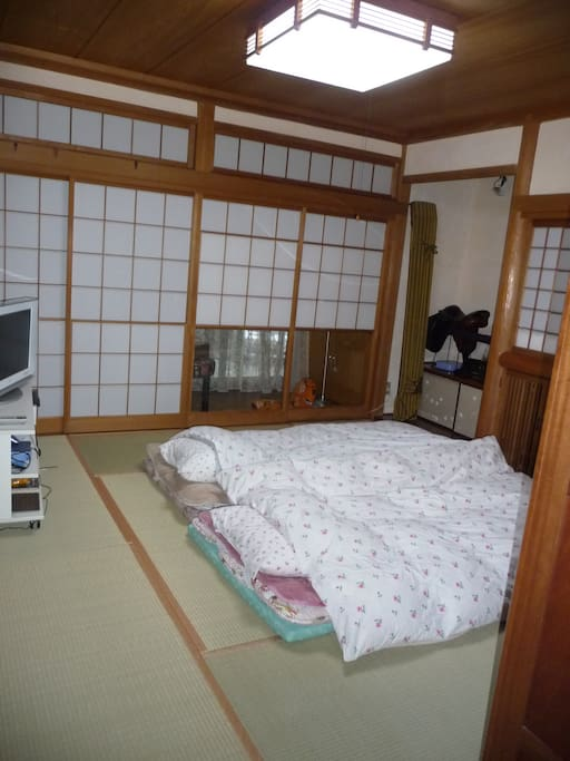 Bedroom with futons for two persons with possibility of putting other arranging futons for third or even fourth persons!