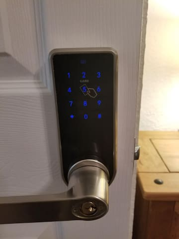 "Keyless entry door lock (available entry methods are RFfob (when the fob is over the ""5"" your door will be locked, four digit pin, or physical key)"