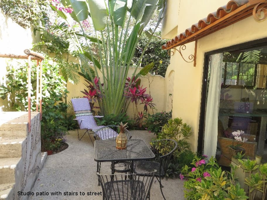 Private patio with secured private entrance to the street
