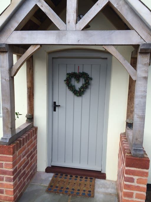 At Christmas Barn Owl Cottage's festive front door.