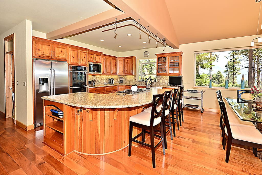 The kitchen, open to the dining space, features a large island that seats 4.