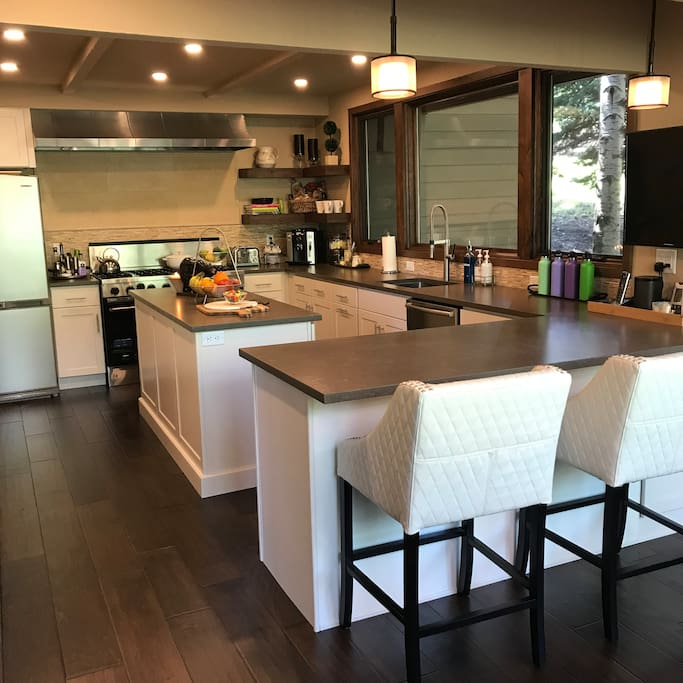 Enjoy our newly remodeled kitchen with a wall of windows, 8-burner Viking Range with two ovens, microwave, warming drawer and all the cooking gadgets you will need.