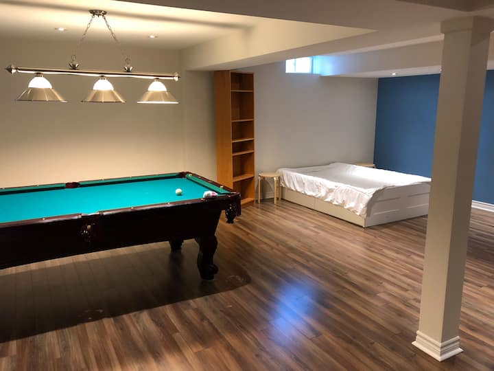Luxurious basement suite with private bathroom.