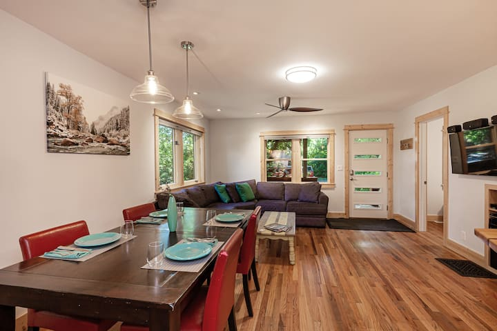 The Cabin offers a nice living and dining room space for its guests.