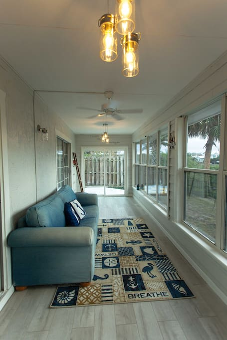 Sunroom to take the view or nap on a rainy day.