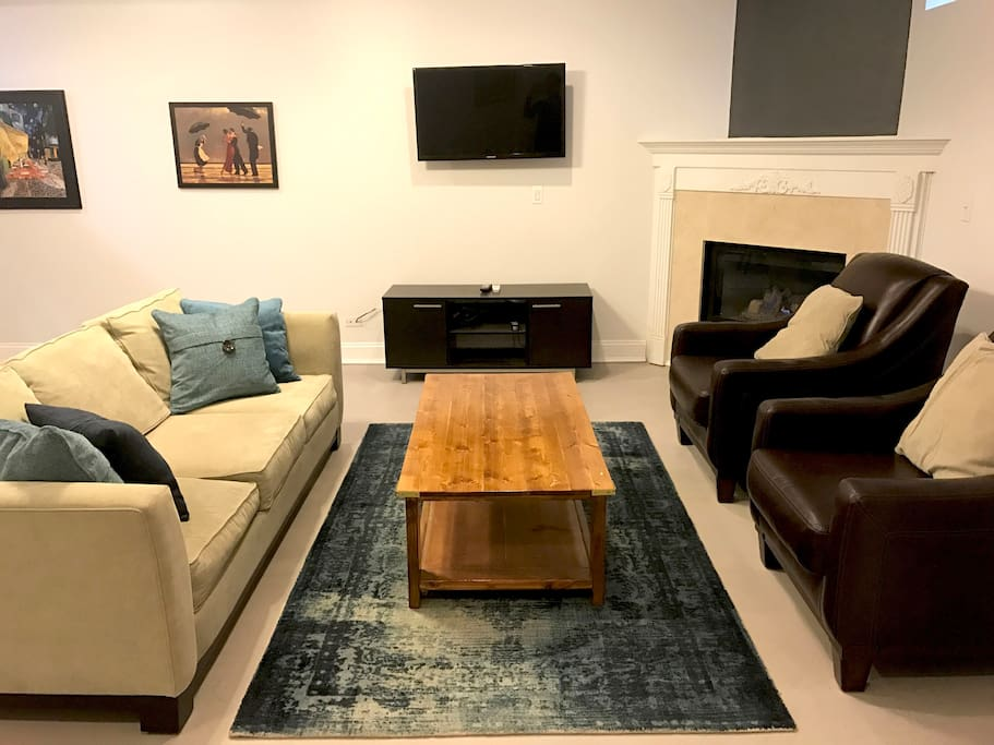 Living room includes pullout queen size mattress, fireplace and cable tv