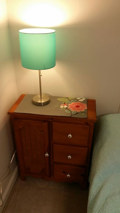 Lamp next to bed for easy access at the night.