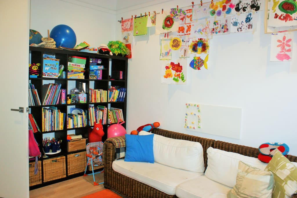 Separate kids playroom with own TV.