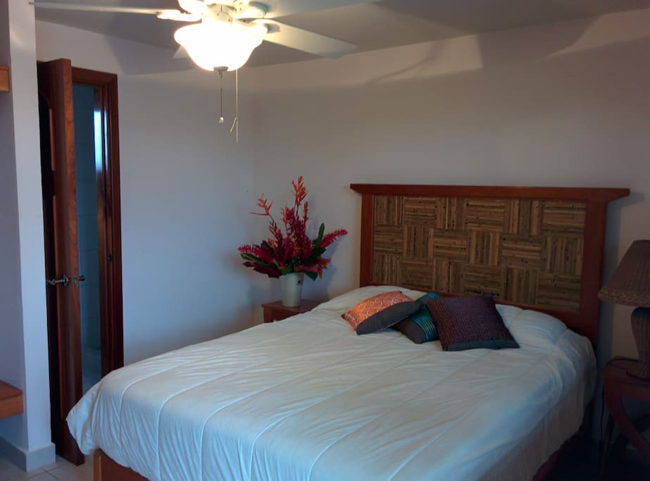 A queen sized bed made from tropical hardwoods