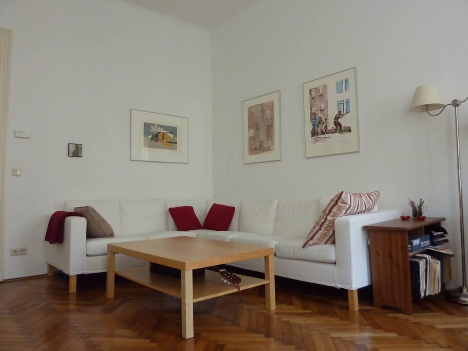 Sofa, table, guitar, feel at home.