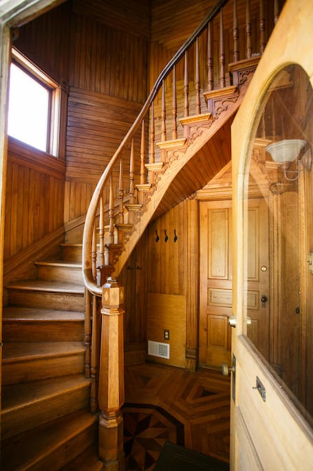 Spiral staircase leads up to private apartment