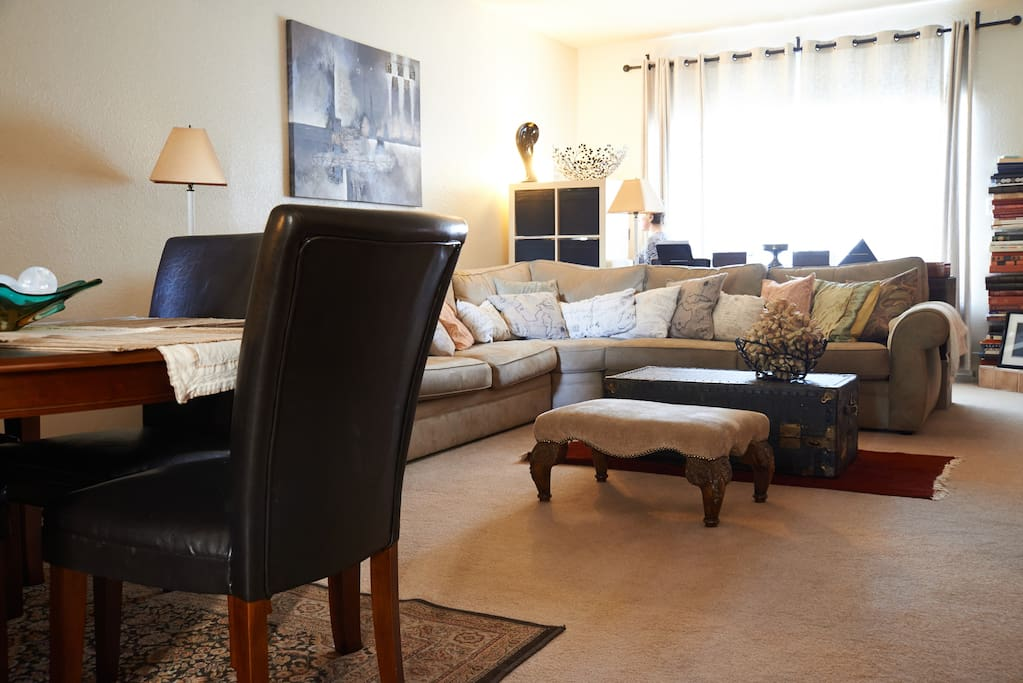 Functional main room includes sectional for lounging and table for eating.