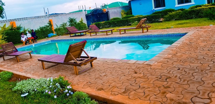 Stylish African Duo with Pool & Grass Chalets
