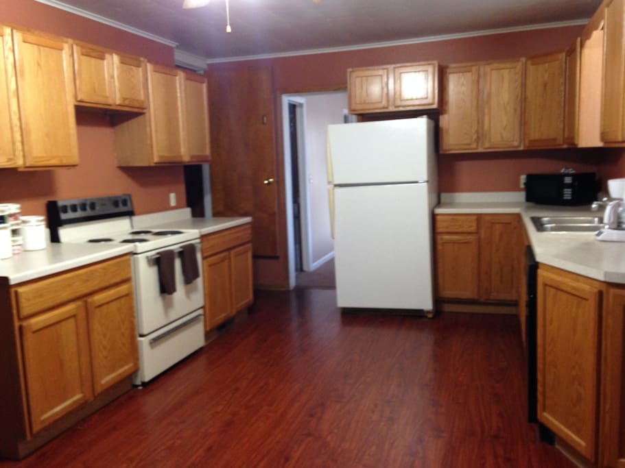 Farmhouse Kitchen - complete with stove/oven, dishwasher, full fridge, pots and pans, dishes, ect..