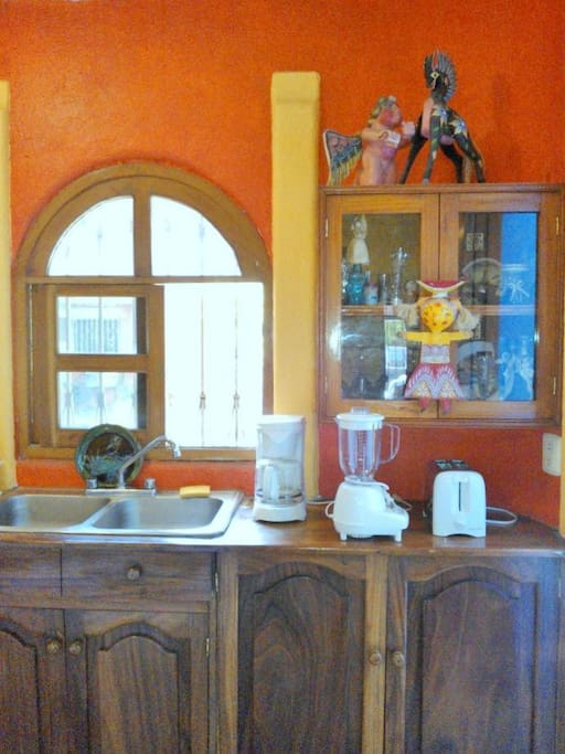 Kitchen appliances; window looks out to courtyard.