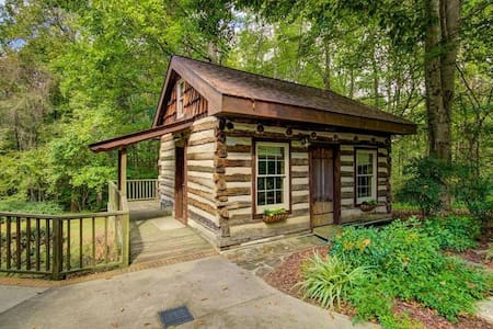 Cozy Authentic Log Cabin tucked away-over 9 acres.