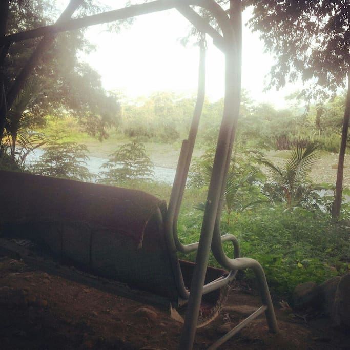 Swinging bench overlooking river