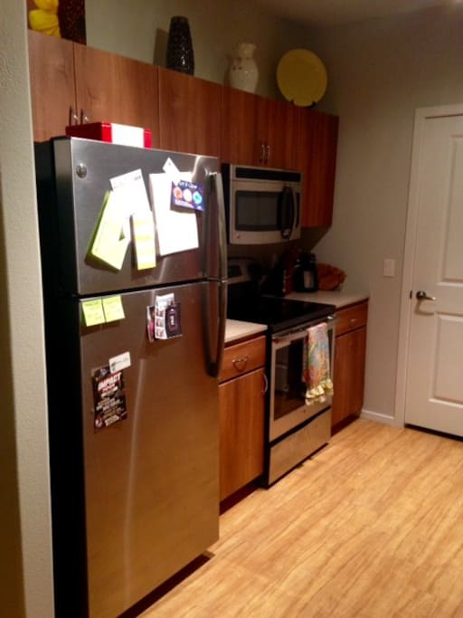 New stainless steel appliances, electric stovetop, oven, microwave, toaster, and Keurig. Not shown - attached laundry room