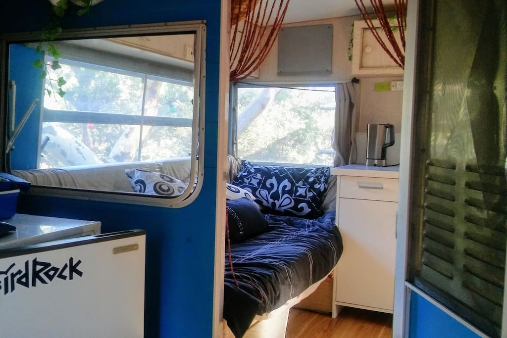 Daybed/single bed as you enter the interior of the caravan. At the opposite side is the double bed.