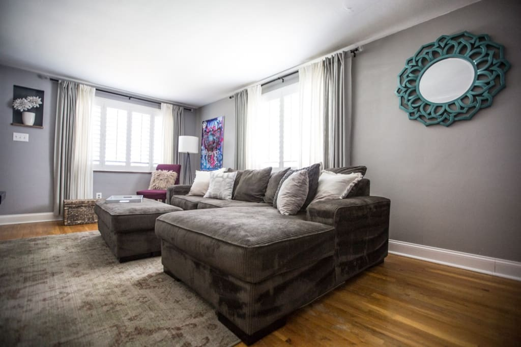 Living room offers a great space to relax and unwind after a football game or day downtown.
