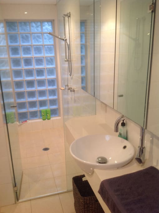 Private bathroom with huge sunny shower and bath.