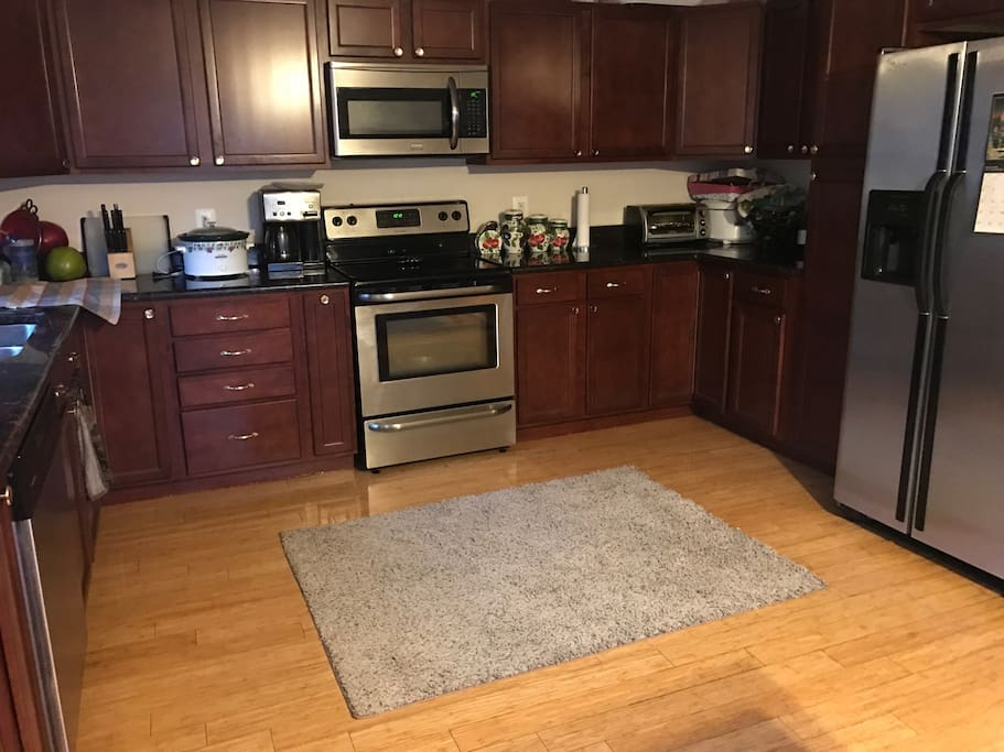 Kitchen includes; microwave, oven, toaster oven, blender, refrigerator with ice maker, and coffee machine.