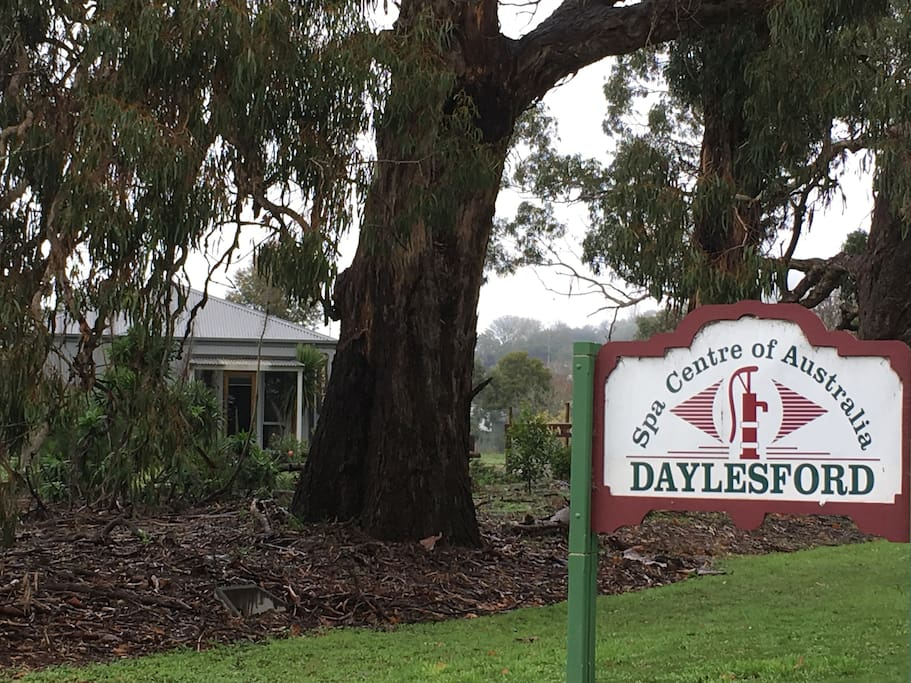 Ashlar in the background of the welcome to Daylesford sign....