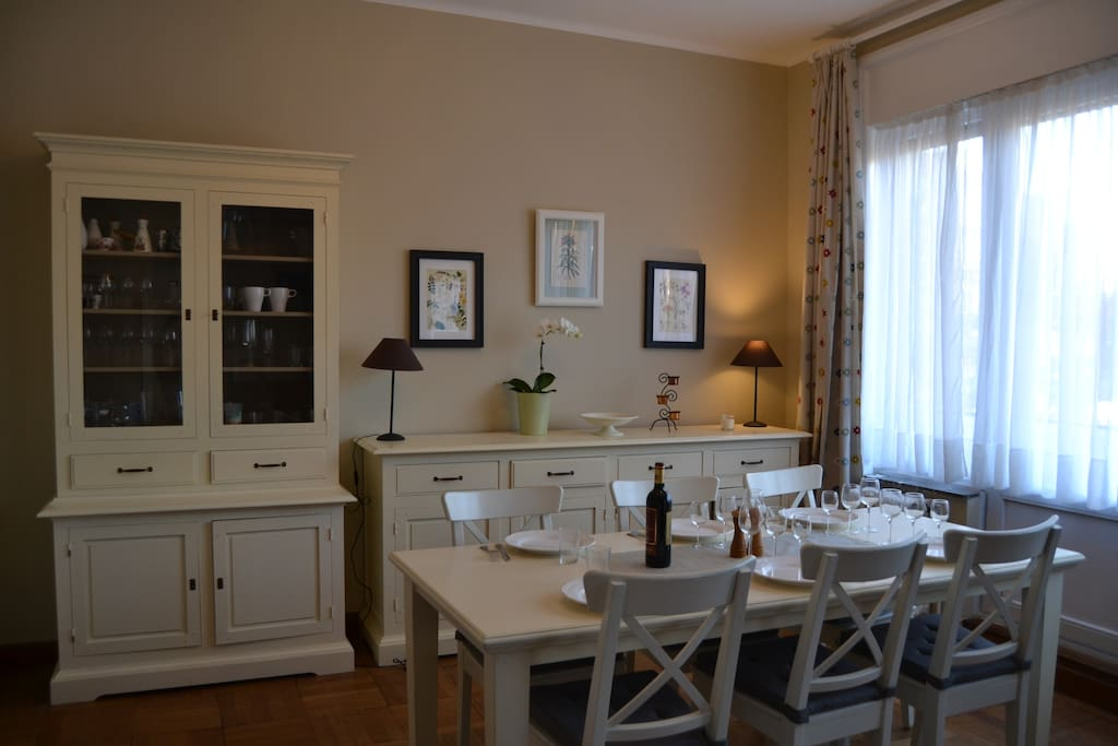 White cottage dining room.   Dishes and tableware available in buffet for 6 persons