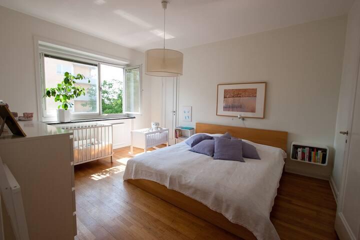 Spacious master bedroom with adjacent bathroom.